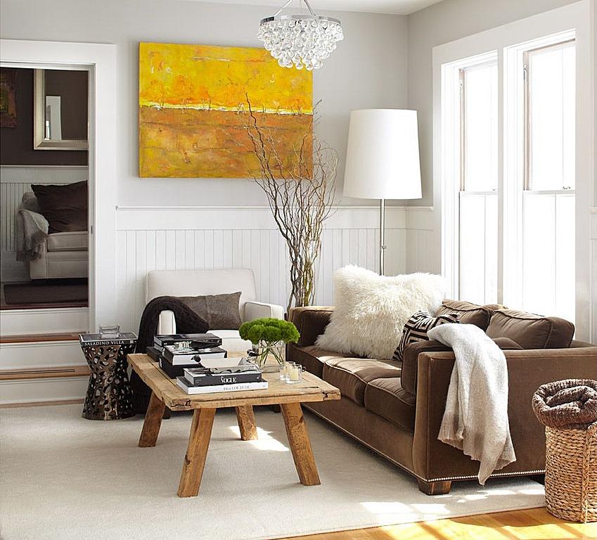 White walls balance rustic textures. Design by Urratia Design.
