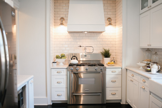 White cabinets and tile dramatically changed the space.