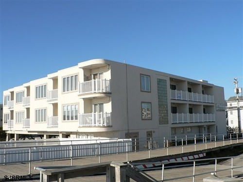 This beachfront condo has ocean views from the deck. At $279,900, it is affordable for the average buyer.