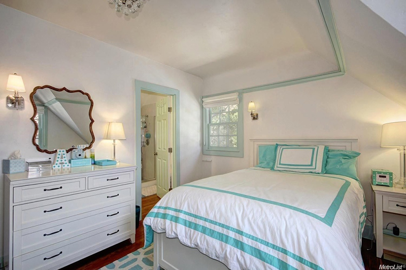 After: White and teal give the room a more grown-up look.