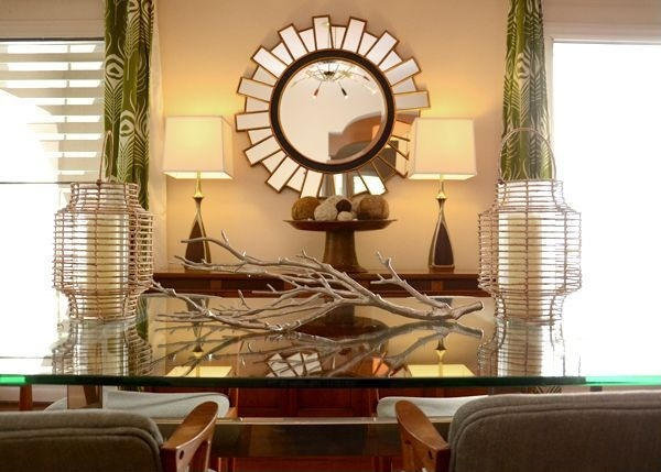 A branch placed on a console table adds a fall flavor to rooms.
