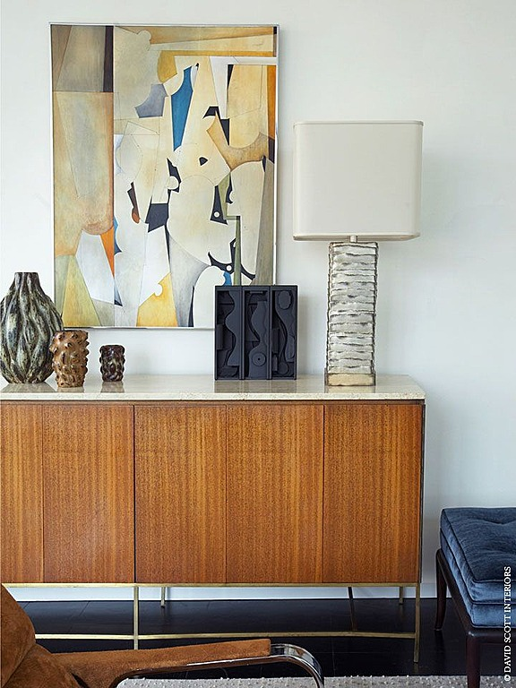 This sideboard, pictured in a room done by David Scott Interiors, is a classic mid-century piece.