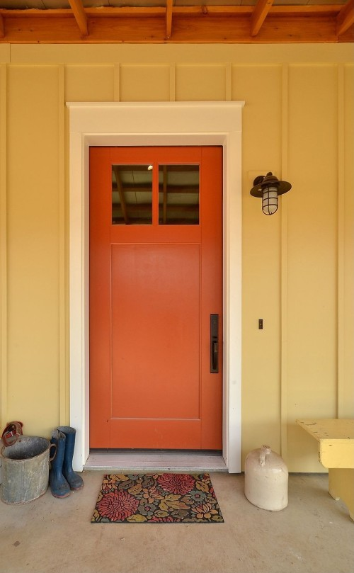 TrueHome Design Build brought an urban feel to this farm house with a contemporary front door.