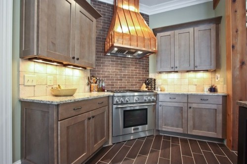 Kitchen with cabinet lighting