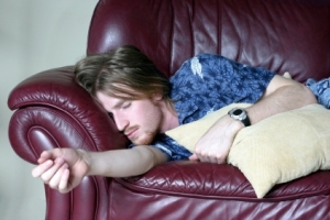 Lazy guy sleeping on couch