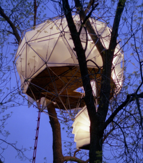The Leaf House by O2 Treehouse is dubbed the 'floating lantern'  because of its striking silhouette against the night sky.