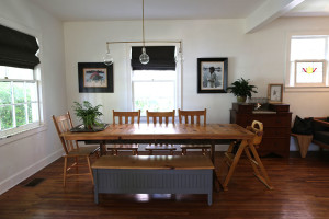 The McLeods' dining room table is made of reclaimed tongue-and-groove flooring.