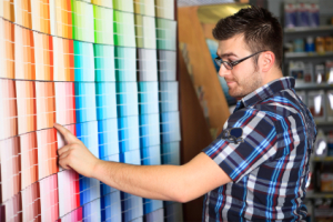 Man choosing paint