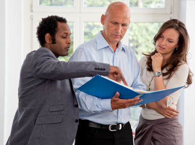 Entrepreneurs Looking at a Binder