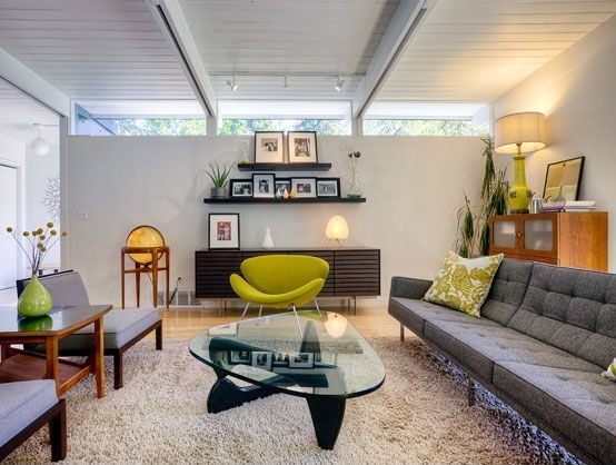 This room layers designs -- including those with a mid-century modern influence -- to create this living room.