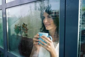 Woman-staring-out-the-window-38b5f3-300x225.jpg