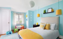 White bedding with pops of yellow make this child's room fun.