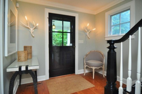 A black door is unexpected and chic. Source: ZIllow Digs