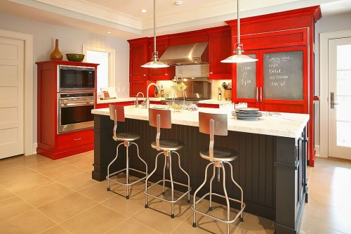 Cherry red and chalkboard paint liven up a kitchen. Source: Jason Landeau