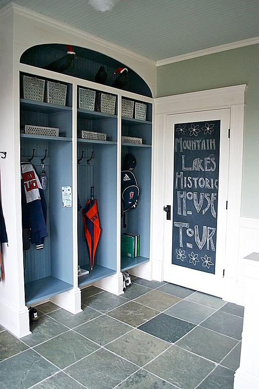 Add chalkboard paint to the inside of a door panel in a mudroom by Carisa Mahnken.