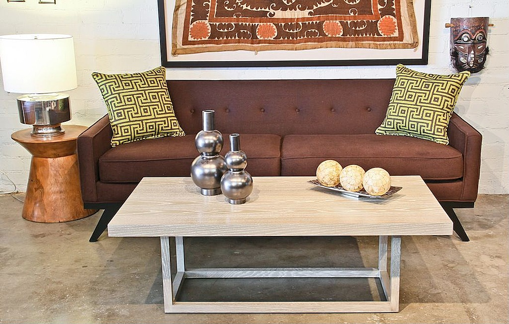 A mid-century-style coffee table can be a room's statement piece.