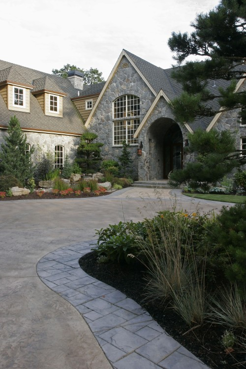 Pavers dress up the edge of this driveway. Source: All Oregon Landscaping