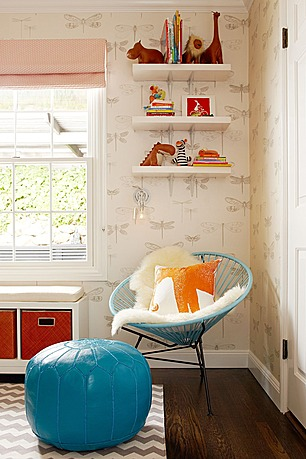 A punch of color is found in the aqua, orange and red touches in the room.