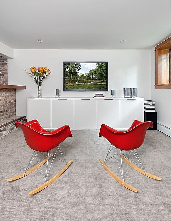 Red Eames-like chairs pop in this neutral space.