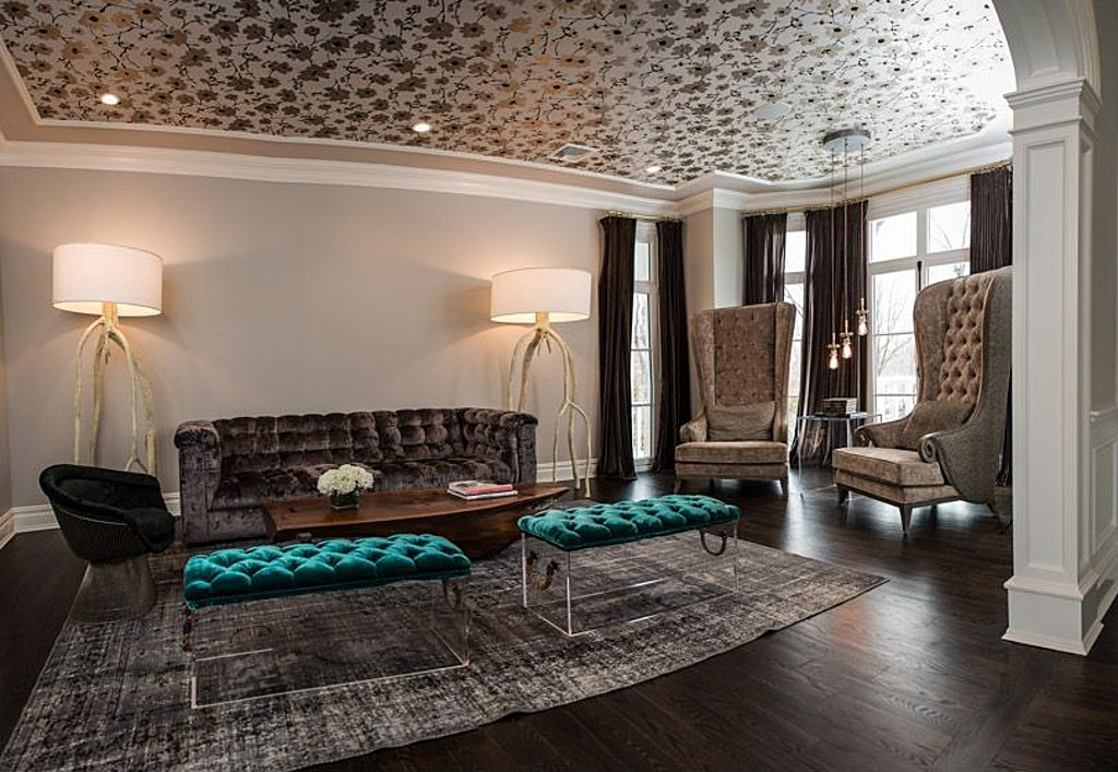 The ceiling features a gold print, but the legs of the coffee table are silver.
