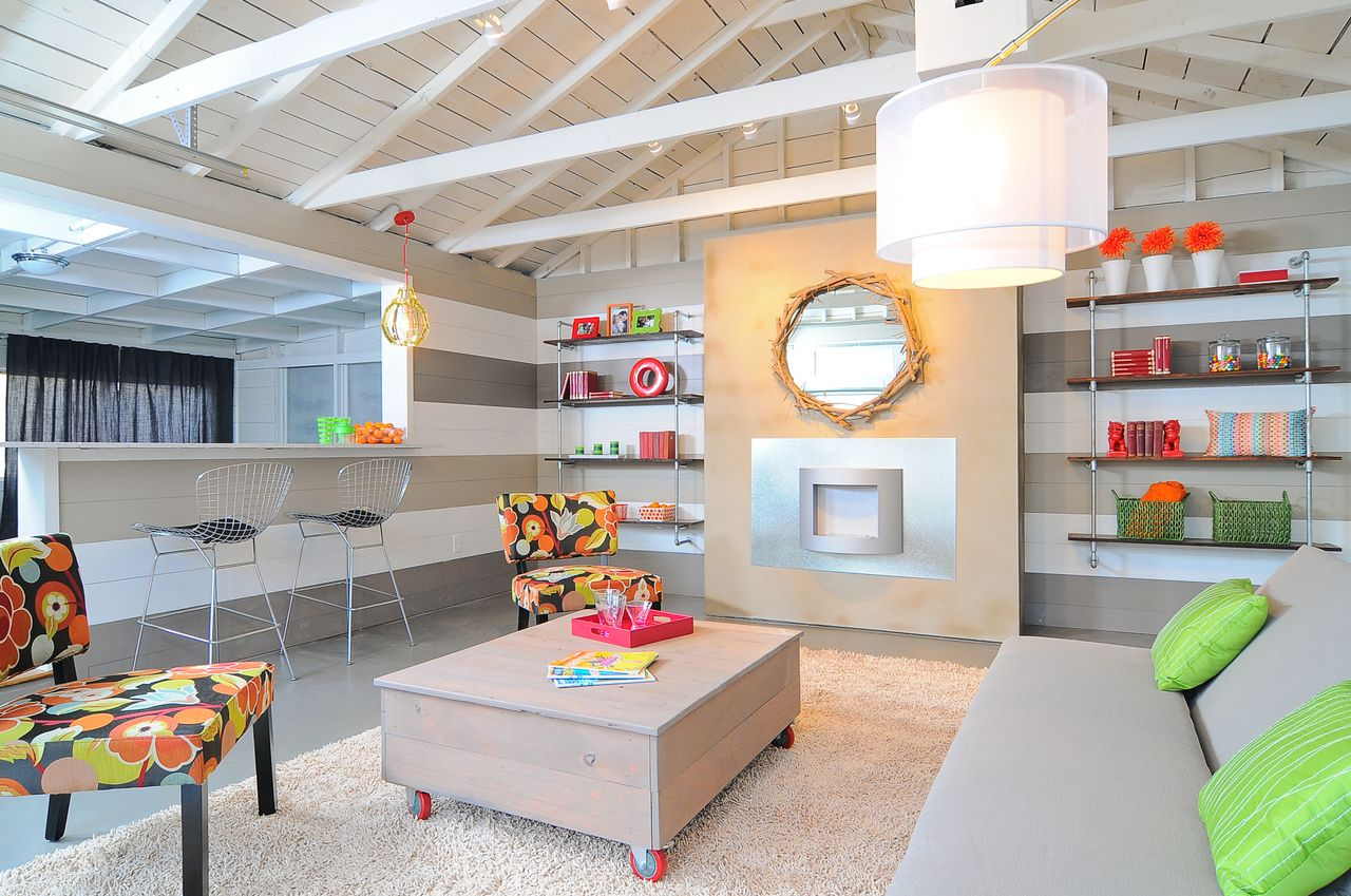 Gray stripes are a neutral backdrop for pops of bright neon. By Kerrie Kelly Design Lab.