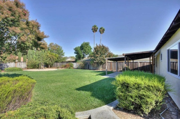 Even if the yard is simple, cut grass and clean pathways make an impact. Source: Zillow Digs.