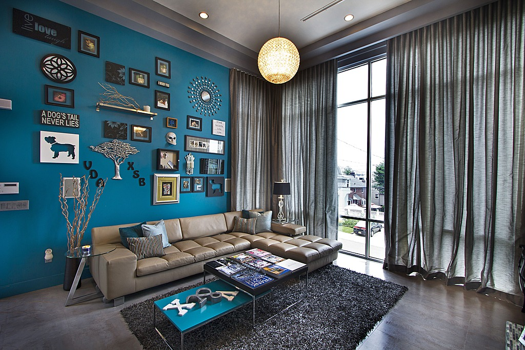 A bright jade statement wall livens up the living room by Vanessa DeLeon Associates.