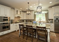 Typically traditional kitchens have white cabinets with detailed molding, vintage drawer pulls or other antique hardware, marble or light-colored granite counters, crown molding, dark wood floors and wainscoting.