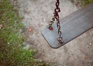 Empty wooden swing