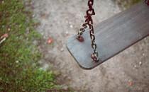 Empty wooden swing