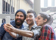 Three friends take a Selfie with phone; Shutterstock ID 257218336